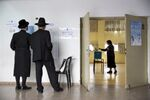 An ultra-Orthodox Jewish woman votes for Israel's parliamentary election at a polling station in Bnei Brak, Israel, Tuesday, April 9, 2019