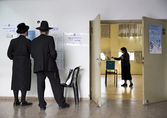 An ultra-Orthodox Jewish woman votes in Israel's parliamentary election at a polling station in Bnei Brak, Israel, 9 April 2019