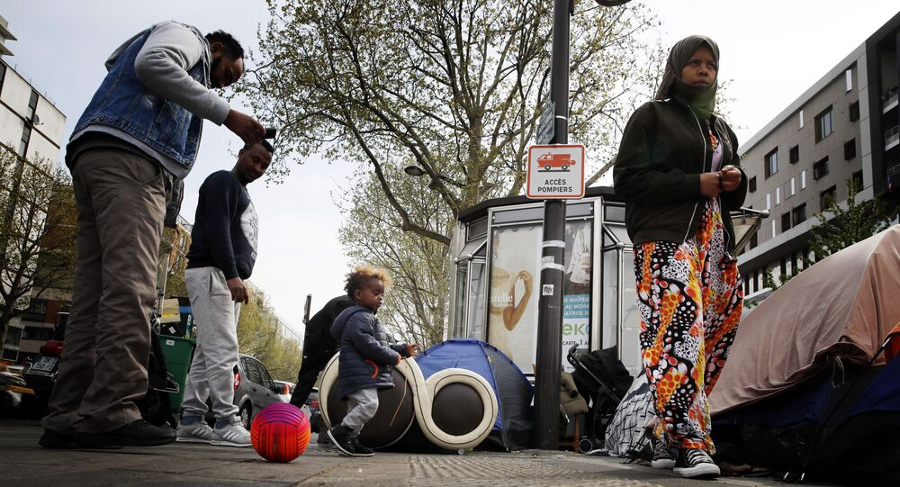 Migrants mainly from Sudan, Chad, and Afghanistan, gather in a makeshift camp along side the Porte d'Aubervilliers, in Paris Monday, April 8, 2019