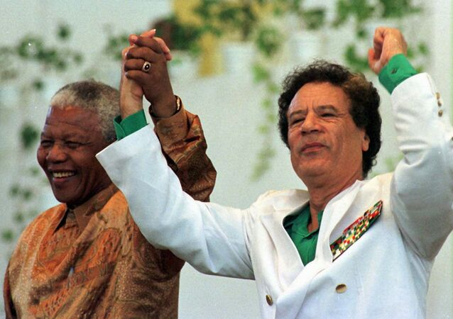 Muammar Gaddafi and Nelson Mandela, file photo.