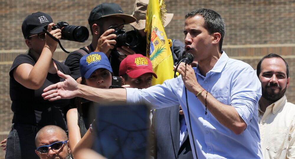 Opposition leader and self-proclaimed interim president Juan Guaido speaks to supporters during a rally to protest outages that left most of the country scrambling for days in the dark in Caracas, Venezuela, Saturday, April 6, 2019