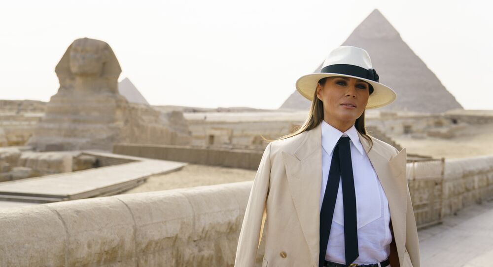 US First Lady Melania Trump pauses as she speaks to media as she visits the historic site of Giza Pyramids near Cairo, Egypt, 6 October, 2018