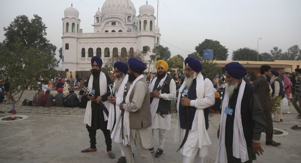 In this Nov. 28, 2018 file photo, Indian Sikh pilgrims visit Gurdwara Darbar Sahib, the shrine of their spiritual leader Guru Nanak Dev in Kartarpur, Pakistan
