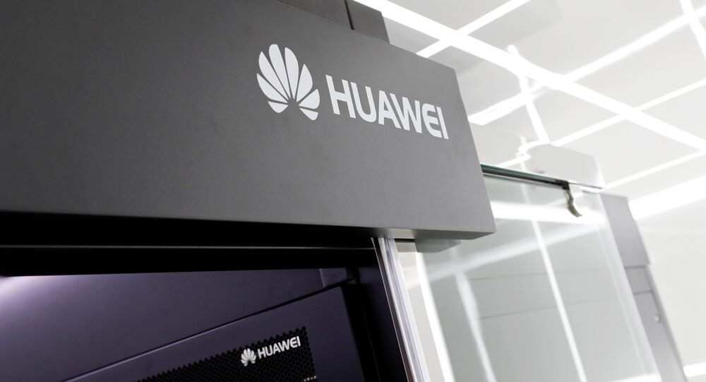Logos of Huawei are seen on a device at its showroom in Shenzhen, Guangdong province, China, 29 March, 2019