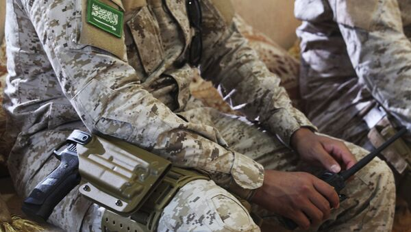 In this Wednesday, Nov. 28, 2018, photograph, an armed Saudi soldier holds a walkie-talkie near Mukalla, Yemen, at an airport now serving as a military base for the United Arab Emirates. - Sputnik International