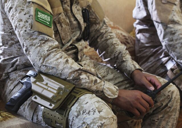In this Wednesday, Nov. 28, 2018, photograph, an armed Saudi soldier holds a walkie-talkie near Mukalla, Yemen, at an airport now serving as a military base for the United Arab Emirates.