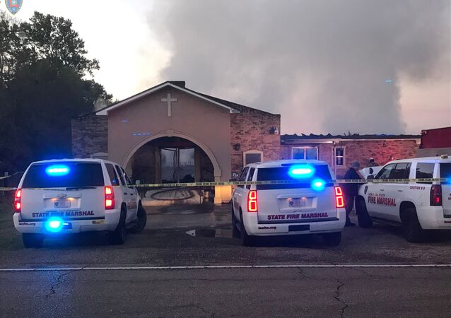 Louisiana State Fire Marshall vehicles are seen outside the Greater Union Baptist Church during a fire, in Opelousas, Louisiana, U.S. April 2, 2019 in this picture obtained from social media