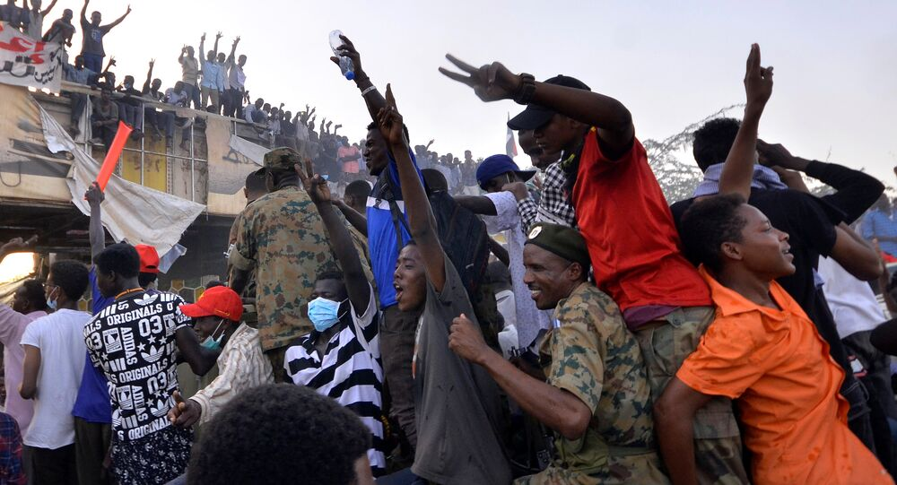 Sudanese demonstrators ride on a military truck as they chant slogans during a protest rally demanding Sudanese President Omar Al-Bashir to step down, outside Defence Ministry in Khartoum, Sudan April 9, 2019
