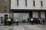 Police clear the way of waiting media outside Westminster magistrates court in London, Thursday, April 11, 2019