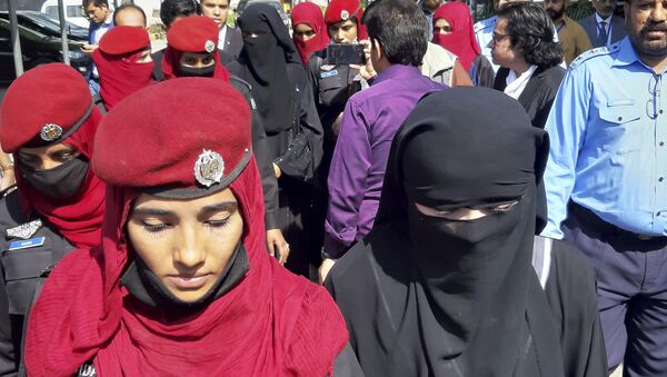 Pakistani girls from the Hindu community wearing black veils, arrive at a court in Islamabad, Pakistan, Tuesday, March 26, 2019. A Pakistani court placed two teenage sisters from the minority Hindu community in a government shelter on Tuesday as authorities launched an investigation into whether the girls were abducted and forced to convert and marry two Muslim men - Sputnik International