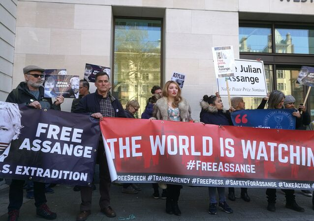 Protesters rally in front of the Westminster Magistrate's Courthouse in London in support of Wikileaks founder Julian Assange