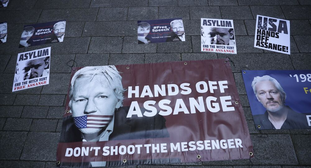 Banners in support of WikiLeaks founder Julian Assange are displayed outside Westminster magistrates court where he was appearing in London, Thursday, April 11, 2019.
