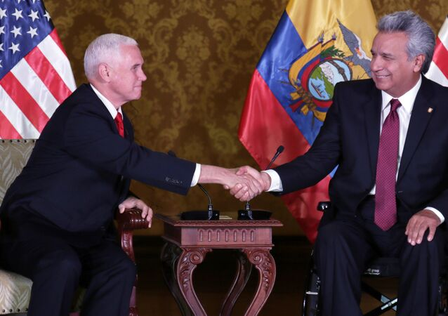Ecuador's President Lenin Moreno, right, shakes hand with U.S. Vice President Mike Pence