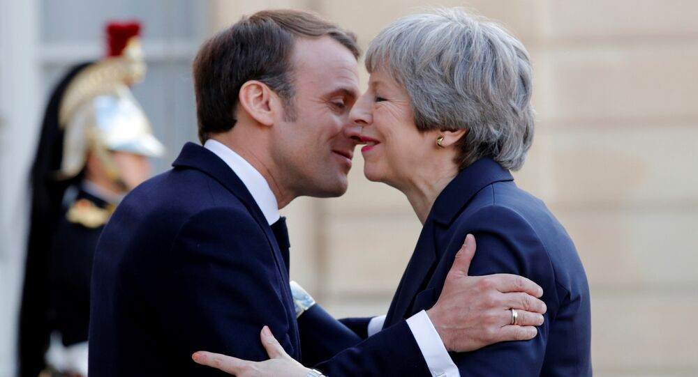 French President Emmanuel Macron welcomes British Prime Minister Theresa May as she arrives for a meeting to discuss Brexit, at the Elysee Palace in Paris, France, April 9, 2019