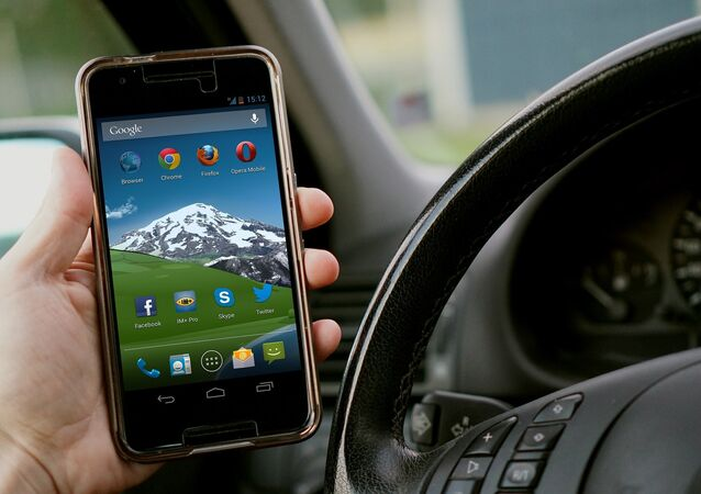 Driver holding a smartphone