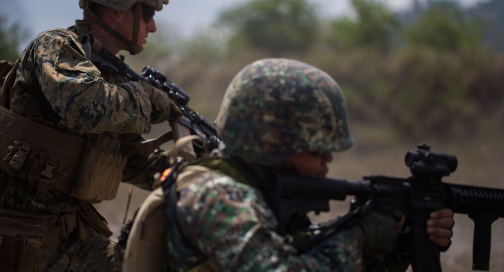 U.S. Marines serving with 3rd Battalion, 6th Marine Regiment and Philippine Marines serving with 58th Marine Corps, 8th Marine Battalion, engage targets on a live-fire range at Colonel Ernesto Ravina Air Base, Philippines, April 6, 2019, during Exercise Balikatan.