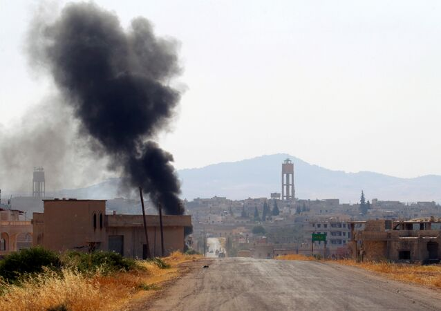 Smoke rises from Taybat al Imam town after rebel fighters from the hardline jihadist Jund al-Aqsa advanced in the town in Hama province, Syria August 31, 2016. (archives)
