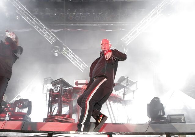 Maxim Reality, left, and Keith Flint, center, of Britain's punk band The Prodigy perform on stage during the Gampel Open Air Festival in Gampel, Switzerland, Thursday August 17, 2006. (KEYSTONE/Olivier Maire)