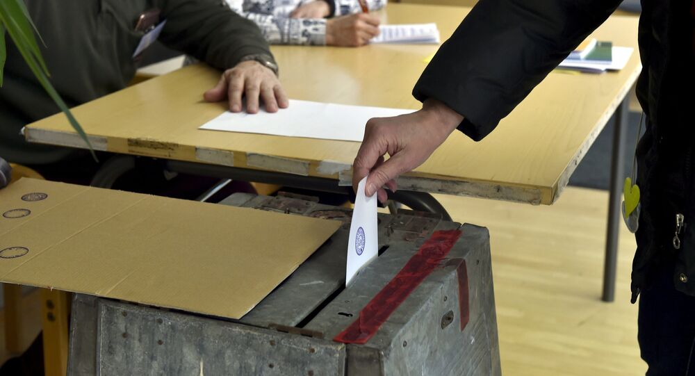 A voter casts his vote at Mantsala town hall during the Finnish parliamentary elections, in Mantsala, Finland April 14, 2019.