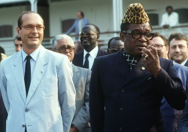 The late President of Zaire, Joseph Mobutu Sese Seko, welcomes France's President Jacques Chirac to Kinshasa in 1985