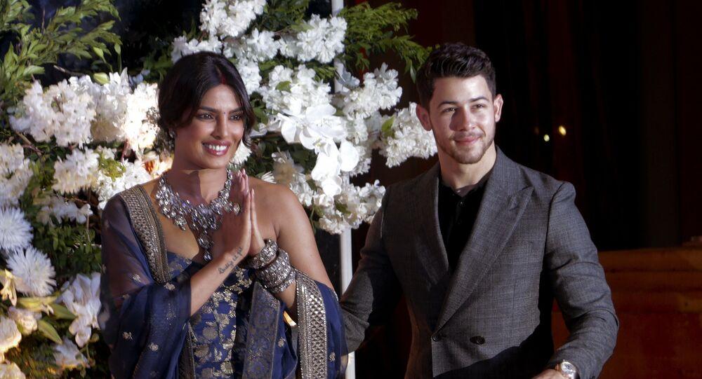 Bollywood actress Priyanka Chopra and musician Nick Jonas pose for photographs at their wedding reception in Mumbai, India, Wednesday, Dec 19, 2018