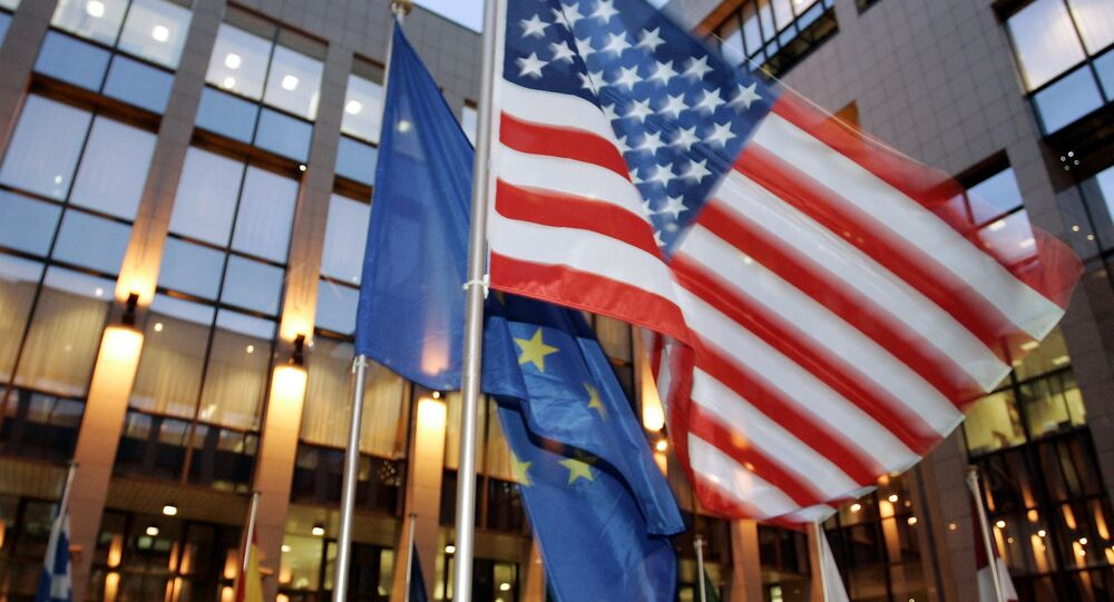 US and EU flags flutter in front of the EU headquarters in Brussels (File)