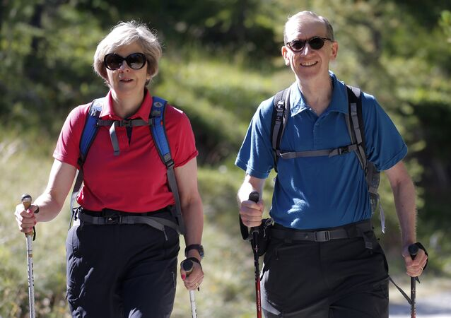 Theresa May and her husband on a walking holiday in Switzerland in 2016