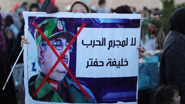 Libyan protesters attend a demonstration to demand an end to the Khalifa Haftar's offensive against Tripoli, in Martyrs Square in central Tripoli, Libya, 12 April, 2019 - Sputnik International