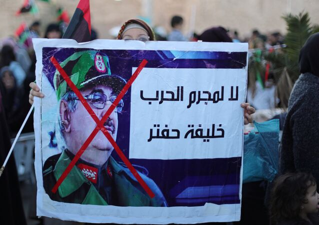 Libyan protesters attend a demonstration to demand an end to the Khalifa Haftar's offensive against Tripoli, in Martyrs Square in central Tripoli, Libya, 12 April, 2019