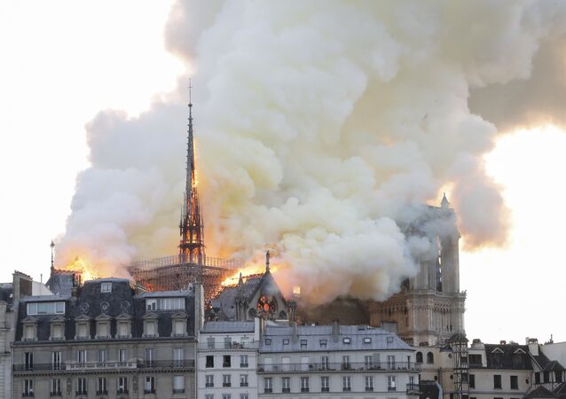Smoke and flames rise during a fire at the landmark Notre-Dame Cathedral in central Paris on April 15, 2019, potentially involving renovation works being carried out at the site, the fire service said.