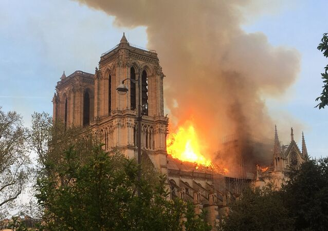 Fire engulfs the iconic Notre Dame cathedral in Paris.