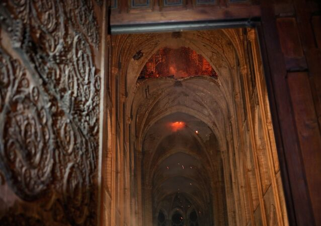 Flames and smoke are seen as the interior continues to burn inside the Notre Dame Cathedral in Paris, France, April 16, 2019.