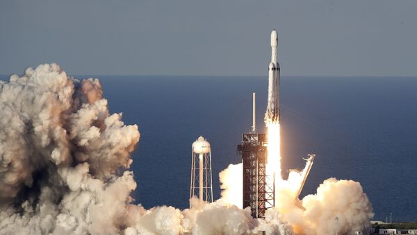 A SpaceX Falcon Heavy rocket carrying a communication satellite lifts off from pad 39A at the Kennedy Space Center in Cape Canaveral, Fla., Thursday, April 11, 2019 - Sputnik International
