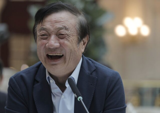 Ren Zhengfei, founder and CEO of Huawei, laughs during a round table meeting with the media in Shenzhen city, south China's Guangdong province, Tuesday, Jan. 15, 2019. The founder of network gear and smart phone supplier Huawei Technologies said the tech giant would reject requests from the Chinese government to disclose confidential information about its customers.