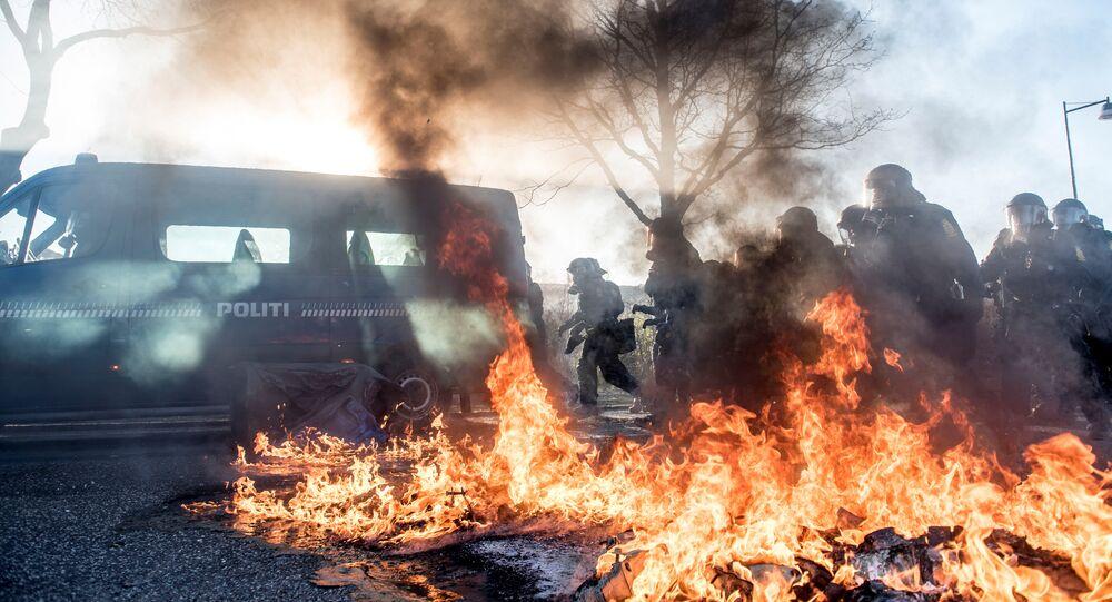 Police and fire are seen in the street in Albertslund, Copenhagen, Denmark April 15, 2019