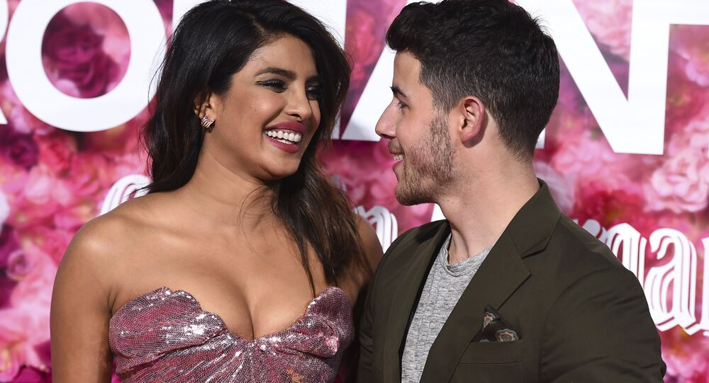 Cast member Priyanka Chopra and her husband, Nick Jonas, arrive at the Los Angeles premiere of Isn't It Romantic at The Theatre at Ace Hotel on Monday, Feb. 11, 2019