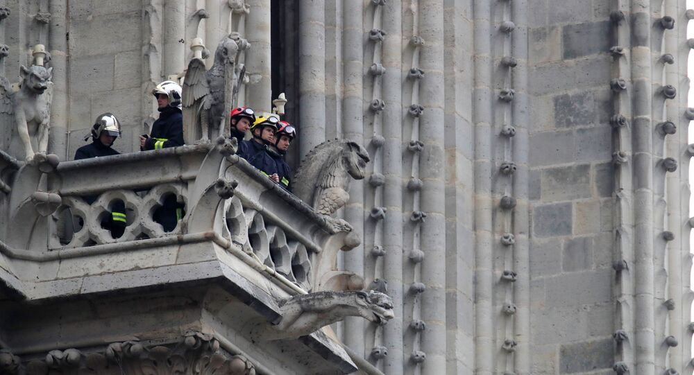 Firefighters work at Notre-Dame Cathedral in Paris, France April 16, 2019