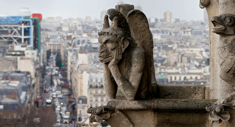 The Stryga, the most famous chimera of Notre Dame Cathedral, overlooks the French capital, in Paris, France, January 14, 2016