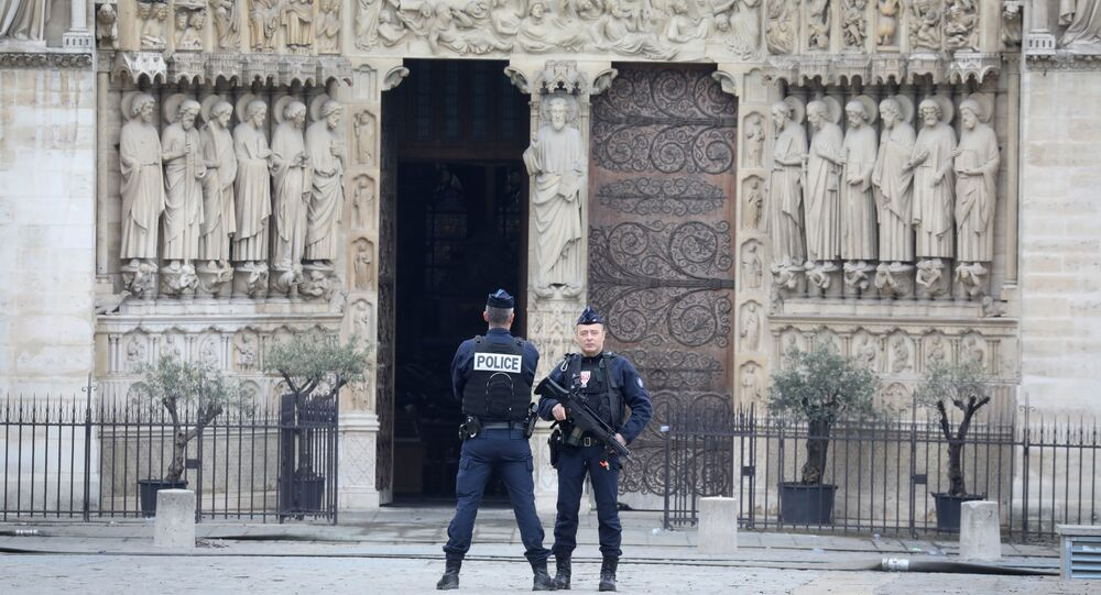 French police officers stand outside Notre-Dame-de Paris on 16 April, 2019 in Paris in the aftermath of a fire that devastated the cathedral