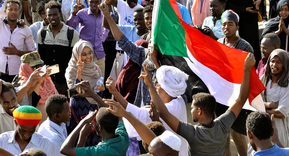 Sudanese demonstrators celebrate after Defence Minister Awad Ibn Auf stepped down as head of the country's transitional ruling military council, as protesters demanded quicker political change, near the Defence Ministry in Khartoum, Sudan April 13, 2019