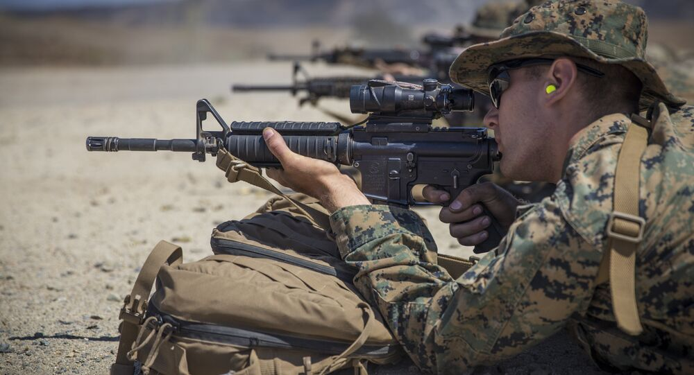U.S. Marine Corps Lance Cpl. Elliot Holter, a heavy equipment mechanic with Combat Service Support Company, I Marine Expeditionary Force Support Battalion (MSB), I Marine Expeditionary Force, zeroes his rifle combat optic on his M4A1 service rifle during a live fire range at Marine Corps Base Camp Pendleton, Calif., Aug. 14, 2018.