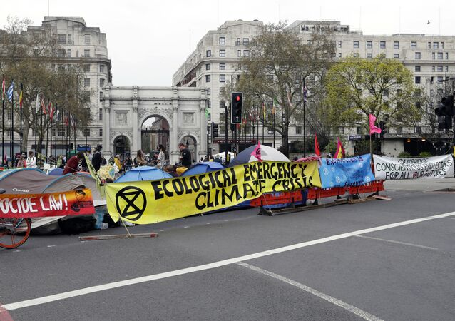The road is blocked by demonstrators during a climate protest at Marble Arch in London, Tuesday, April 16, 2019