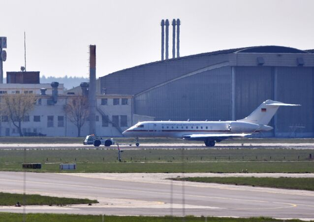 A Global 5000 jet of the government is towed over a taxiway at Schoenefeld Airport in Berlin, on April 16, 2019. After a malfunction shortly after take-off, the aircraft was reversed and landed at Berlin-Schönefeld Airport with major problems