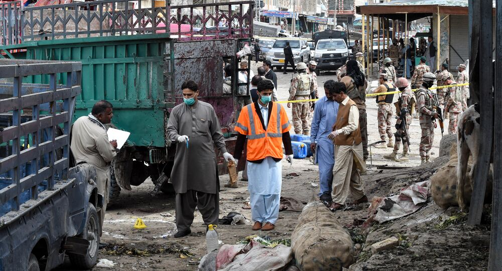 Pakistani security officials inspect the site of a bomb blast at a fruit market in Quetta on April 12, 2019