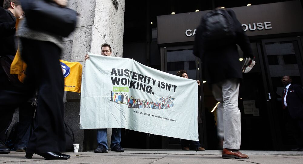 People protesting about the UK government's austerity programme, of which universal credit is the flagship
