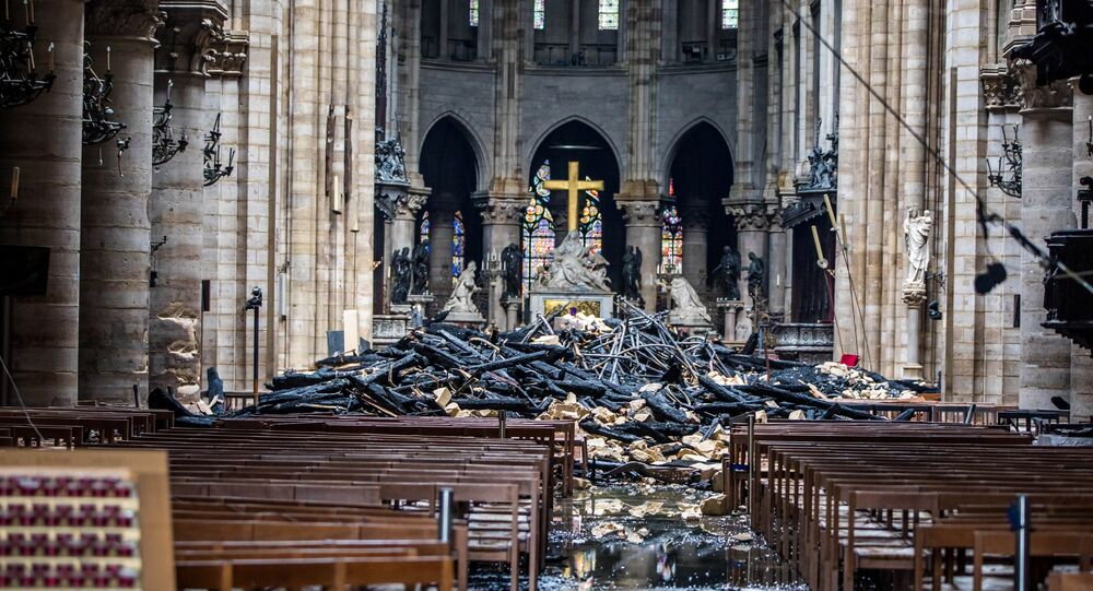 A view of the debris inside Notre-Dame de Paris in the aftermath of a fire that devastated the cathedral, during the visit of French Interior Minister Christophe Castaner (not pictured) in Paris, France, April 16, 2019