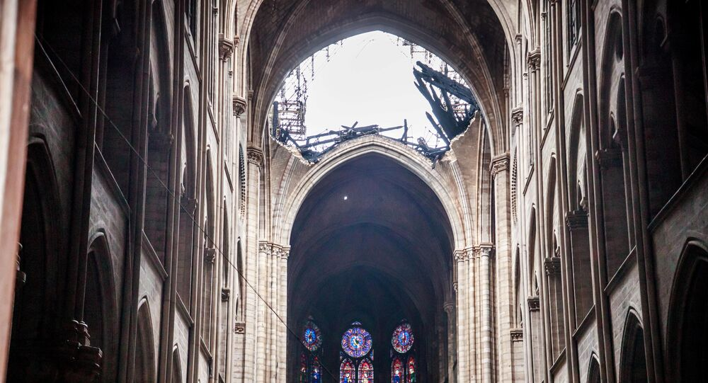 A view of the damaged roof of Notre-Dame de Paris in the aftermath of a fire that devastated the cathedral during the visit of French Interior Minister Christophe Castaner (not pictured) in Paris, France, April 16, 2019
