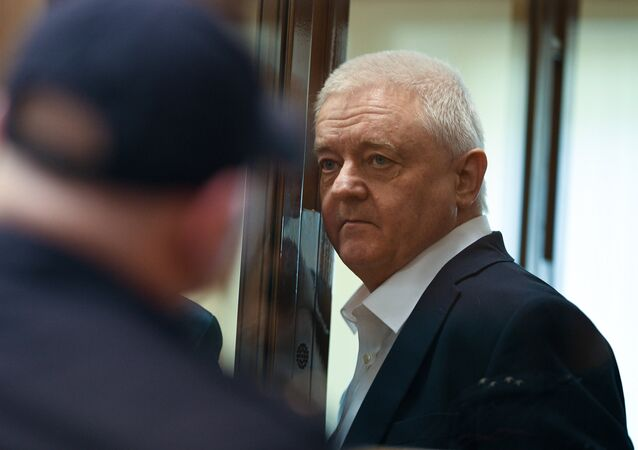 Norway's Frode Berg waits in a cage in a court room in Moscow, Russia. The court has found Berg guilty of espionage for collecting data on Russian nuclear submarine and sentenced him to 14 years in a high-security jail