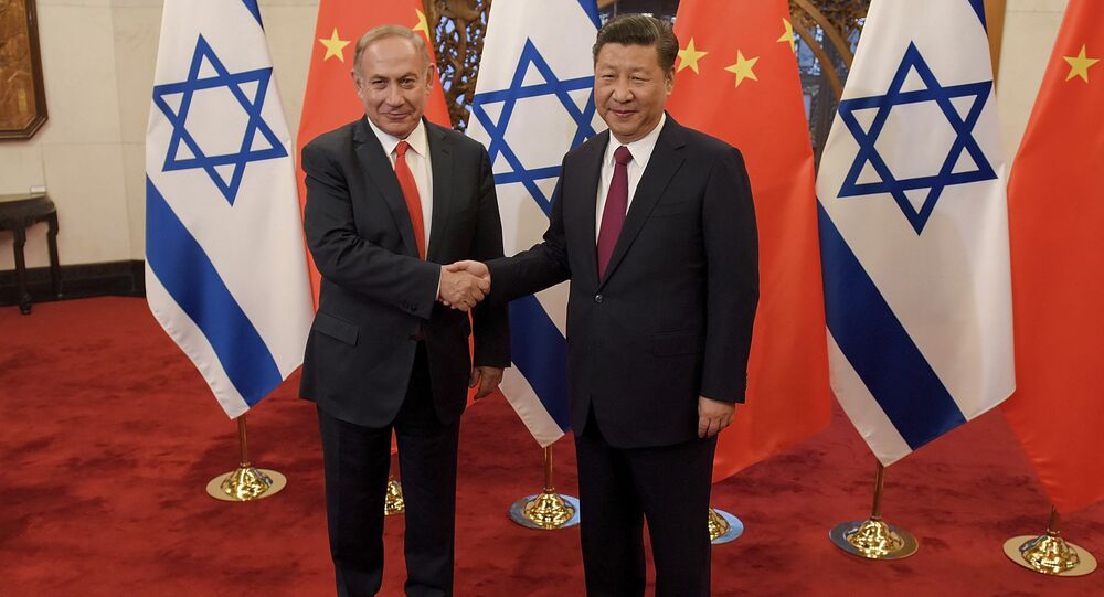 Israeli Prime Minister Benjamin Netanyahu, left, and Chinese President Xi Jinping pose for photographers ahead of their talks at Diaoyutai State Guesthouse Tuesday, March 21, 2017 in Beijing, China