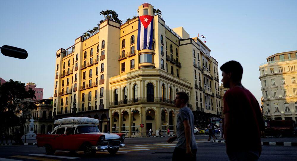 A Cuban flag hangs outside a hotel in Havana, Cuba, April 20, 2018